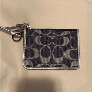 Coach blue jean wristlet.....$60